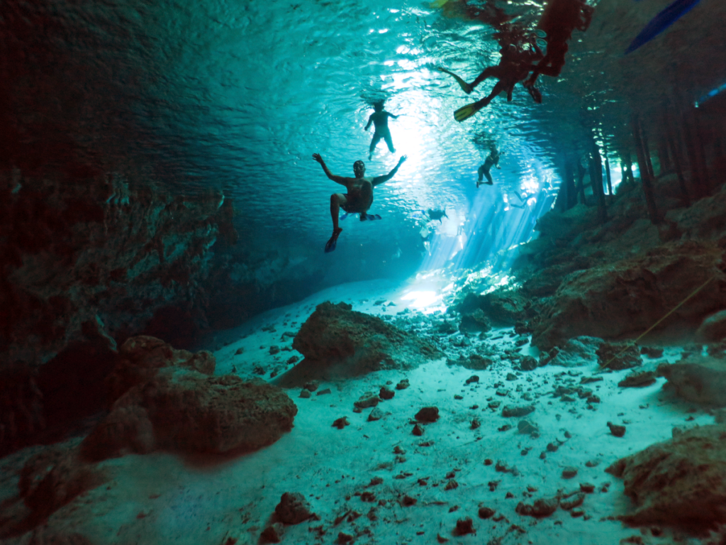 Snokelers and divers at Dos Ojos Cenote